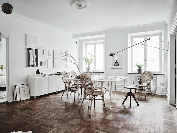 Artist's studio / dining space in a stunning Swedish apartment in neutrals. Entrance / Jonas Bergstedt.