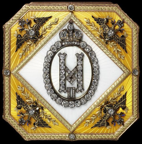 Fabergé varicoloured gold presentation box with enamel and brilliant-cut diamonds. Decorated on the lid with the crowned cipher of Tsar Nicholas II, surrounded by Imperial eagles; mark of Mikhail Perkhin