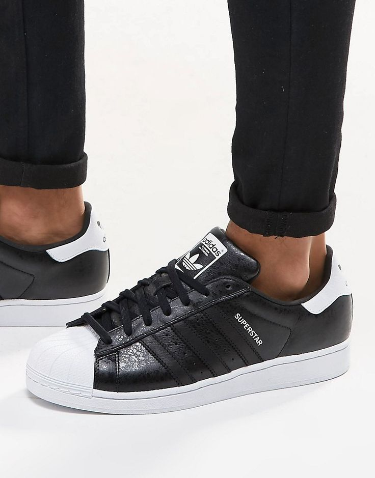 Shop adidas Originals Superstar Trainers In Black at ASOS.