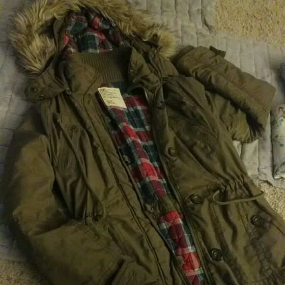 American Eagle Outfitters Fur Jacket Great used condition! Worn maybe 5 times! My loss your gain! Army  green or olive color with detachable fur hood with great winter print inside! American Eagle Outfitters Jackets & Coats
