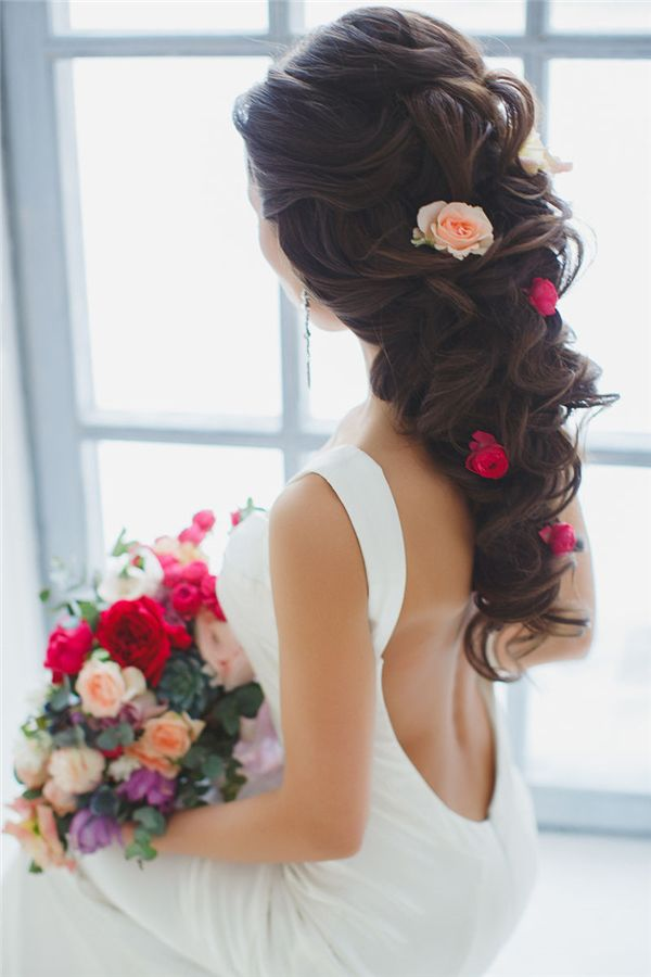 wavy bridal hairstyle for long hair with red flowers