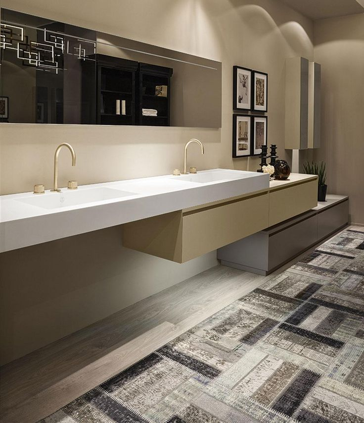 The collection of bathroom furniture Manhattan, by Oasis. Available in many lacquered colors, here with washbasin by Corian, 12 cm thick.