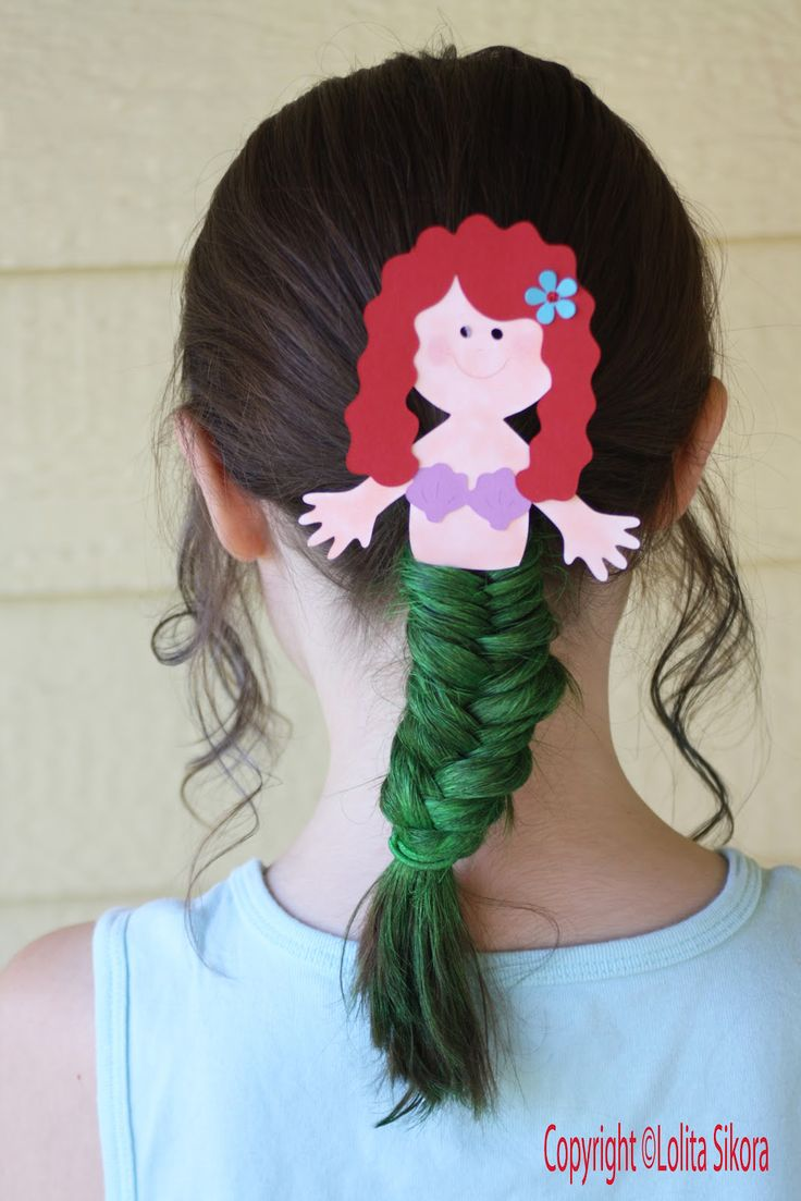 """When we think of """"mermaid hair,"""" we usually envision thick, wavy locks like Ariel's in The Little Mermaid. A fishtail braid is a more literal interpretation —but you won't find this stylish 'do hiding under the sea!"""