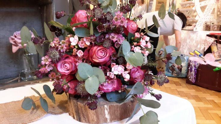 Roses, astrantia, wax flower and phlox . Bridal bouquet marsala tones.
