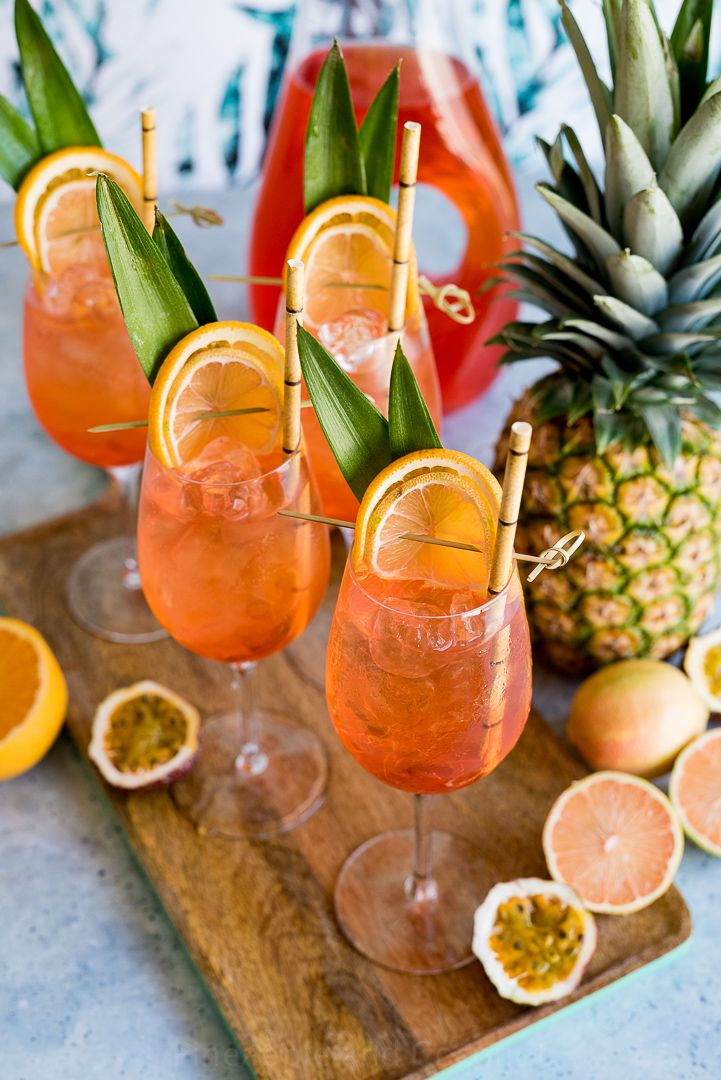 A tropical twist on the oh so popular Aperol Spritz with sparkling roseé in place of traditional prosecco. A refreshing and delicious cocktail. Fancy Drinks, Summer Drinks, Cocktail Drinks, Cocktail Recipes, Alcoholic Drinks, Cocktail Movie, Cocktail Sauce, Cocktail Attire, Cocktail Parties