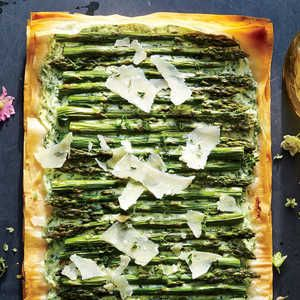 Fresh asparagus rests atop creamy ricotta and a collection of flavorful herbs in this simple appetizer. The beginner-friendly recipe requ...