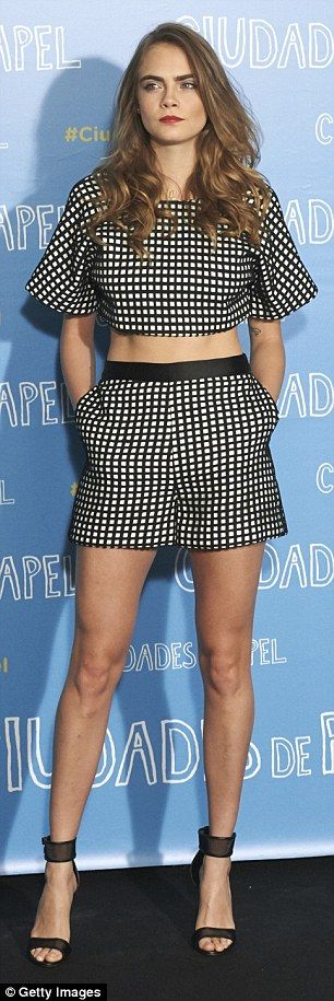 Catwalk star: Cara also showed off her long legs in the shorts and added a pair of towerin...