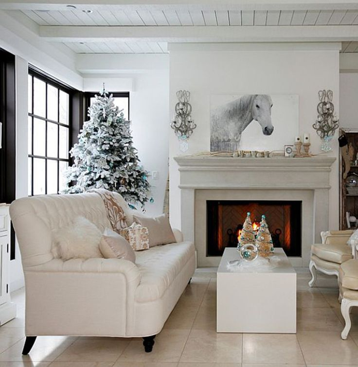 Living Room, Adorable White Christmas Decorations Design With Christmas Tree Silver Accessories And White Puffy Leather Sofa Featuring Fireplace Ideas: Christmas Living Room Decorating Ideas