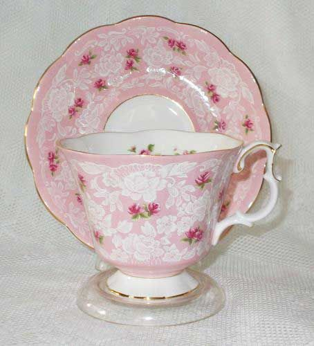 tea cup & saucer. Pink and white with deep ink flowers and all gold rimmed