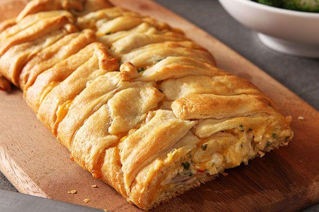 Break out the refrigerated crescent rolls and knock their socks off with this Cheesy Chicken Crescent Roll recipe. This crescent roll recipe is super easy.