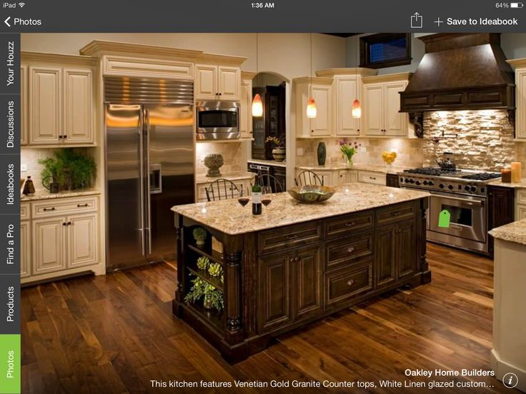 Two toned, and I like the detailing on the island. Much grander than my kitchen but the color scheme is exactly what I have in mind.