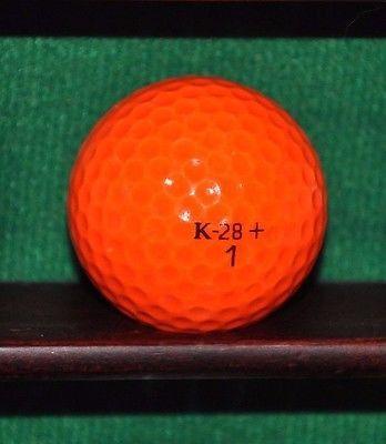 Vintage Wilson K 28 + golf ball. Orange