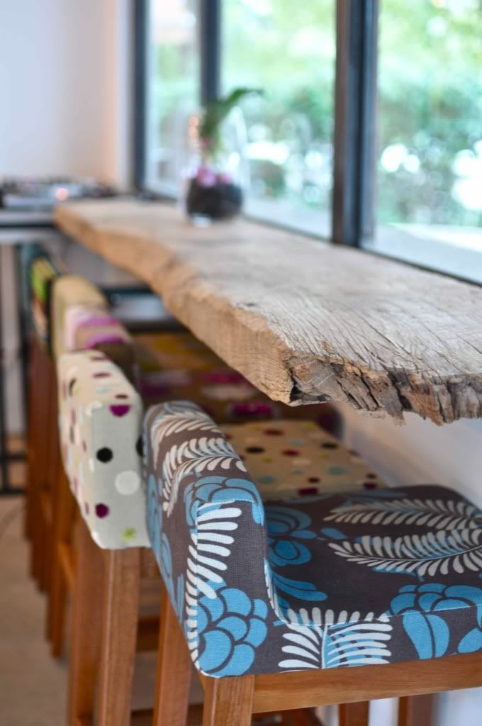 Bar from a reclaimed driftwood & the funky fabric on the high bar stools!!!