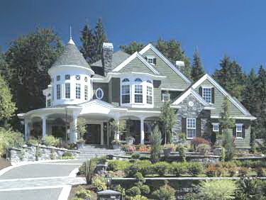 Modern victorian home. Note base color with white turret and trim. Note oval window.