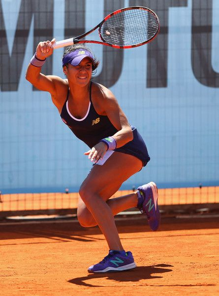 Heather Watson Photos - Heather Watson of Great Britain in action against Mirjana Lucic-Baroni of Croatia in their second round qualifying match during day one of the Mutua Madrid Open tennis tournament at the Caja Magica on April 30, 2016 in Madrid, Spain. . - Mutua Madrid Open - Day One