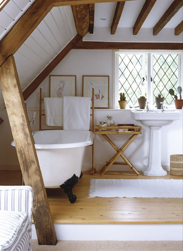 Cottage Chic Bathroom in an attic style room. Great use of space. Love the rustic beams in contrast to the beautiful white!