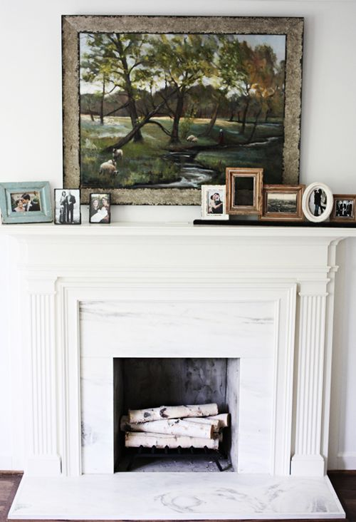 white fireplace + mantle with art: Family Pictures, Grey Wall, Living Room, Design Sponge, Picture Frames, Landscapes Painting, White Fireplaces, Pictures Frames, Light Art
