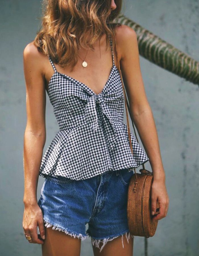 This summer, the one outfit that is getting the most love on Instagram is a gingham top and a basket bag.