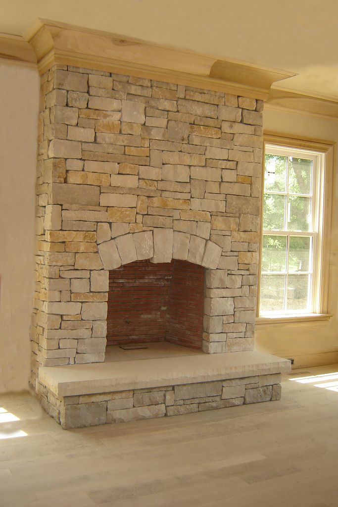 This fireplace has Buechel Stone's Fond du Lac Cambrian Blend with custom Fond du Lac material on the hearthstone and arch. Notice the installation with a drystack installation. Ref: Fond du Lac Cambrian Blenda. Visit www.buechelstone.com/shoppingcart/products/Fond-du-Lac-Ca... for more information.