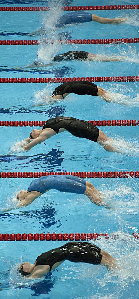 Competitors dive during the Women's 100m Backstroke final during the British Gas Swimming Championships, the British swimming team trials for the London 2012 Olympic Games, at the Aquatics Center in L