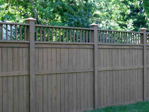 privacy fence...love the gray stain....one day for Honey