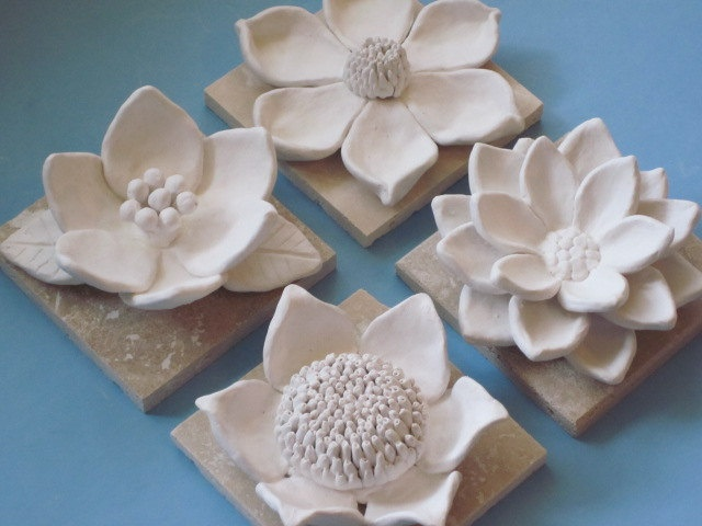 Flower Garden Wall Hanging, ceramic wildflower, blackberry, camelia, and daisy wall sculptures, flower art, floral art, spring, summer. $85.00, via Etsy.