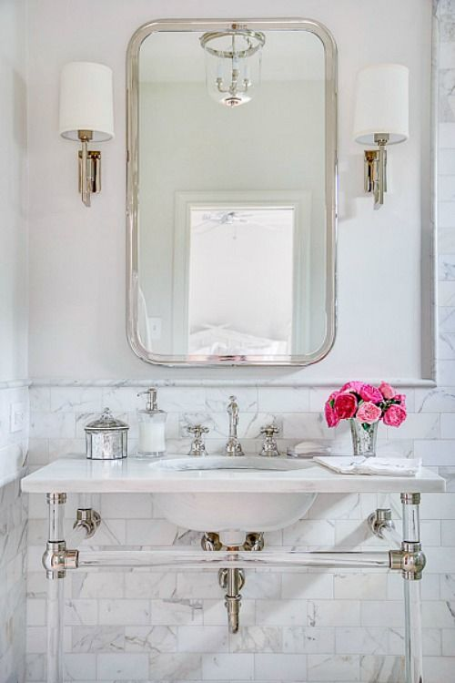 The acrylic rods for this vanity are a perfect choice!  A modern, visually light approach to a traditional bath update.