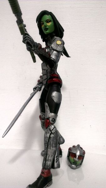this is a marvel legends Gamora (Marvel Now) Custom Action Figure made by figure realmer wings he used a hope summers body, taskmaster sword with darice foam for the shoulderpads and blister card packaging for the visor the rest was sculpted happy pinning