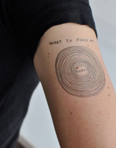 i am fascinated by tree ring tattoos