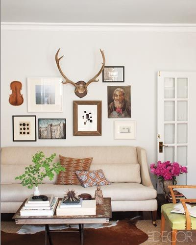 The arrangement of art (and antlers) on the wall.  Now how about one with 10 deer mounts?  How do we make that pretty?