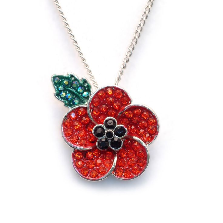 """Poppy 5 Petal Necklace. Complementing our Peace Poppy Brooch is this enamelled pendant necklace which reflects the sentiments of Remembrance in a sensitive, tasteful way. Suspended on an 18'' (46cms) silver chain, the presentation box includes words from Laurence Binyon's famous poem""""They shall grow not old,as we that are left grow old."""""""