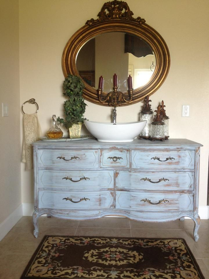 Turn an old dresser into bathroom vanity.