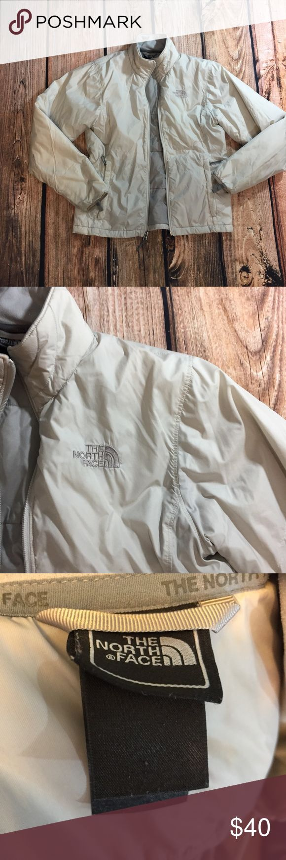 {The North Face} cream & gray coat The North Face Beige/cream colored with gray jacket. Lightweight down filled. Warm and cute jacket. Little mark on the sleeve shown in photos. Size small. Good condition. The North Face Jackets & Coats Puffers