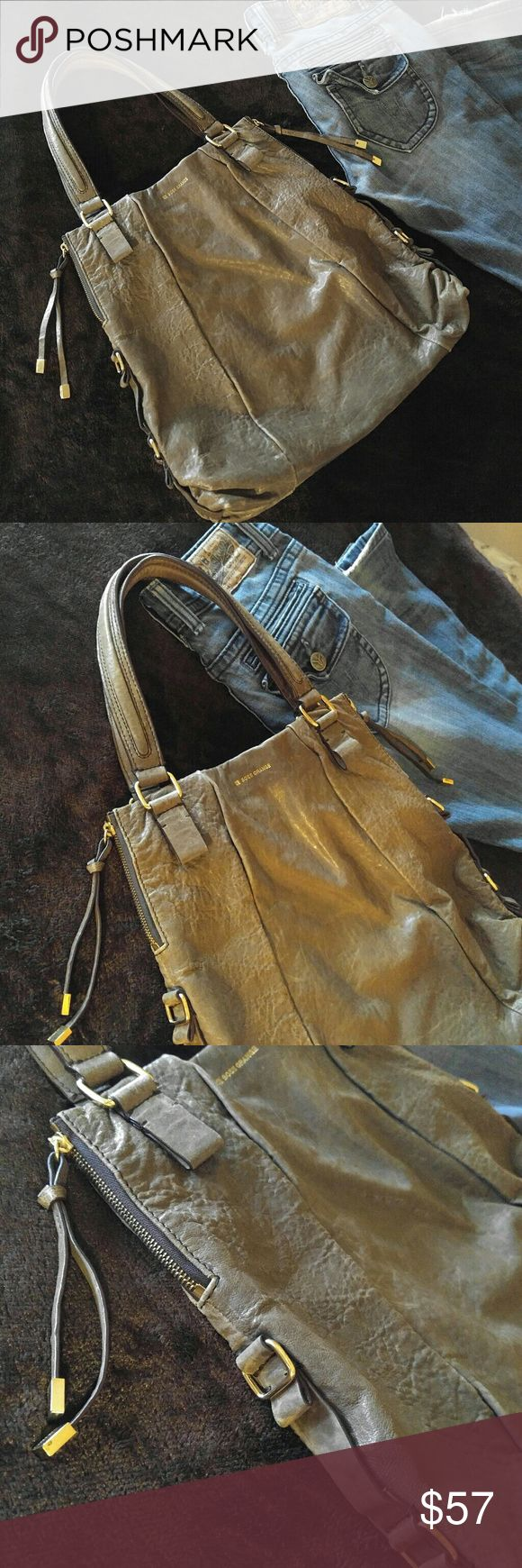 Authentic Hugo Boss Purse Bag Authentic Hugo Boss Purse bag from the Agathe Hugo line. Gorgeous Tan / Beige color. Genuine Grainy Lambskin-- 1 step above cowhide leather.  Gold metal embellishments on sides / side zippers.  Inside: 1 zip pocket, and 2 open pockets. Snap closure. Absolutely NOTHING wrong with bag. Gently used. YEARS of life left in this bag! Last pic shown is from the Hugo Boss website showing this Agathe Line shoulder bag compliment. Exact same material. Posted to see…