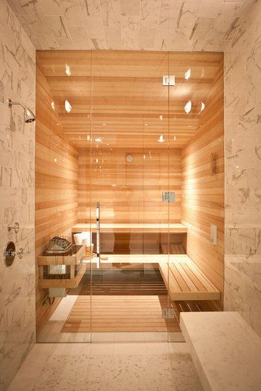A stunning stone steam room leads to the interior sauna.