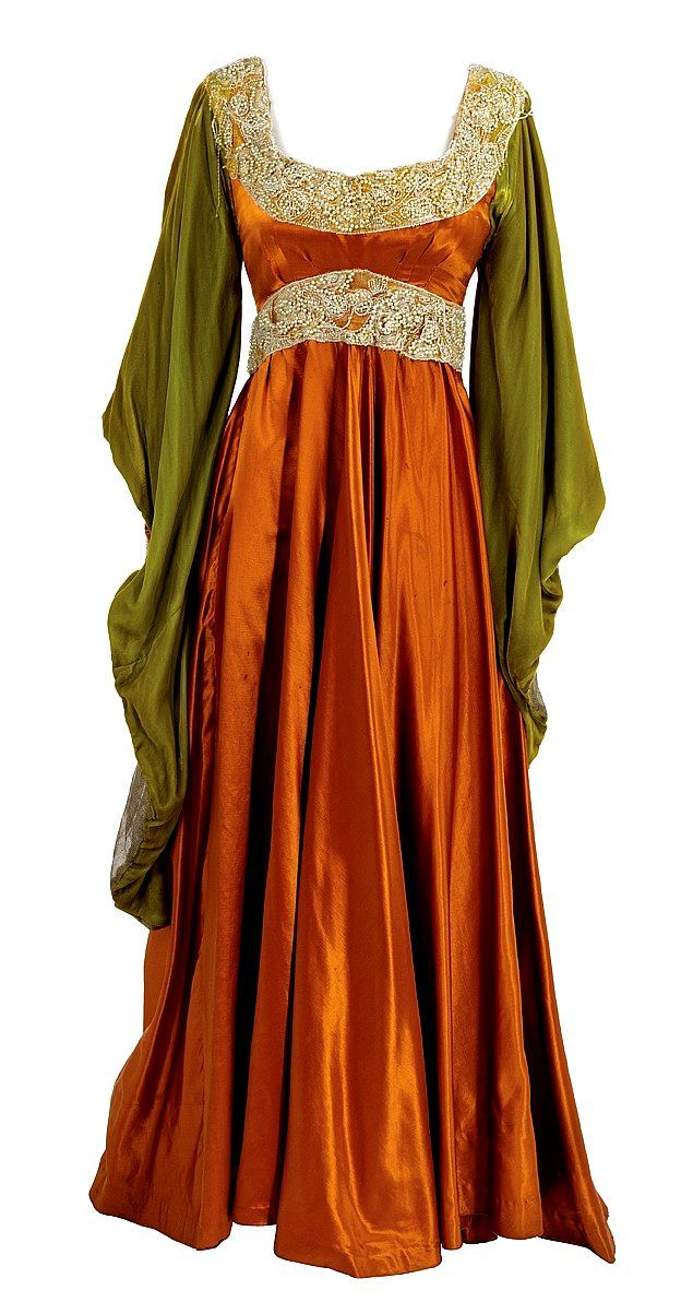 Omg I have a dress just like this but the orange is purple! I have to find it now.