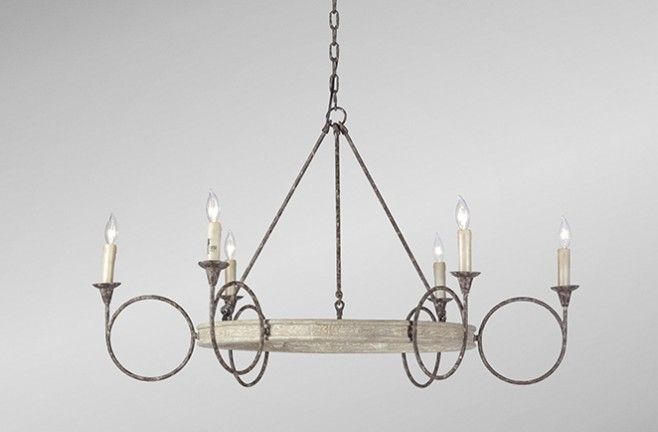 This large circle candle chandelier offers a transitional silhouette of rhythmically repeated circles adorned with antique style finishes of rust and white washed wood. Rustic transitional style abounds in our Bailey's simple geometry and textured finishes for a dramatic yet accessible lighting choice. Drape a swag in the circles for a holiday look. | Bailey Chandelier | Gabby