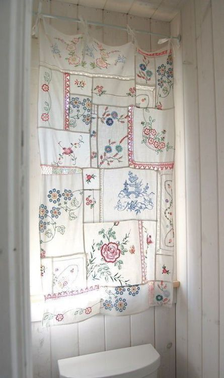 embroidered tea towels sewn together into a curtain