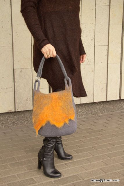 Felted handbag made seamless, from merino wool. Handbag is worn over the shoulder, with one hollow handle. Handle can be shortened. Inside felted 5