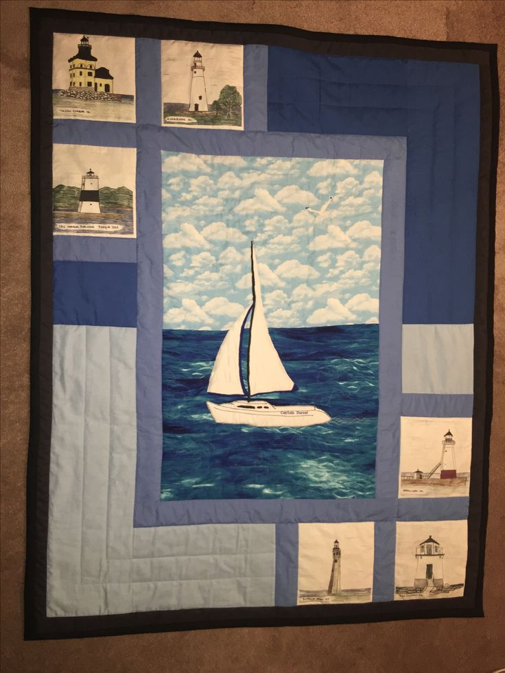 Nautical sail boat. This is  Lake Erie , Husband drew out the light houses in that area then I transferred onto the fabric, sewed it to the quilt.
