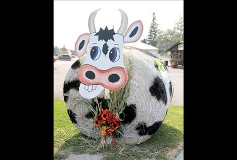Large Round Hay Bale Decorations | Community Bank turned a hay bale into a cow for the competition.