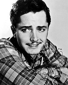 John Derek (August 12, 1926 – May 22, 1998) was an American actor, director and photographer. He appeared in such films as Knock on Any Door, All the King's Men, and Rogues of Sherwood Forest, but was probably best known for marrying glamorous starlets and for launching the meteoric career of his last wife, Bo Derek.