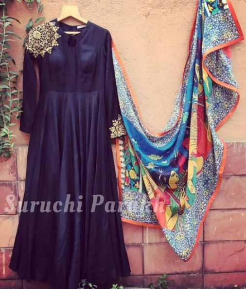 Minimalistic kurta with very off beat zardosi motif placements paired with an equally off beat dupatta by Suruchi Parakh