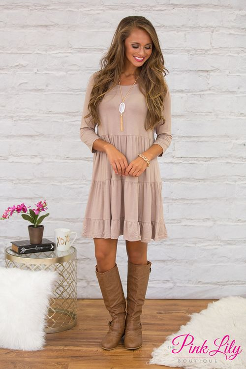 Once this adorable dress has crossed your mind once, you won't forget it! This classic taupe dress is simply perfect for all occasions, with the flattering flowing style and ruffled skirt!