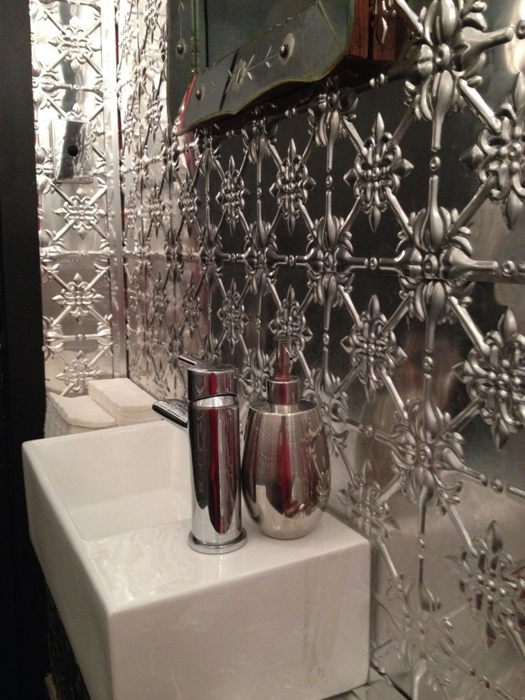 Great use of pressed metal in a bathroom in my local cafe.... Walls and ceiling!