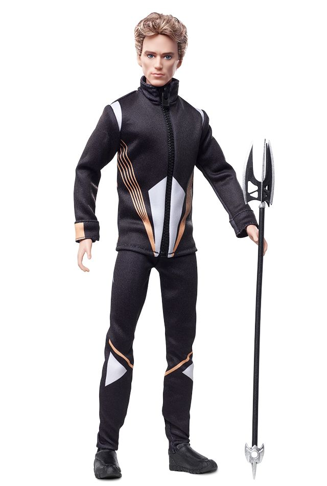 """When former Hunger Games champion Finnick is forced to return to the arena, at first Katniss is wary of the handsome warrior. Soon, she realizes he can be trusted and is a powerful ally in the arena. The Finnick doll wears a zipped jacket with golden and- white stripes and matching pants inspired by the costume worn in the film. Also included is a """"trident spear"""" accessory."""