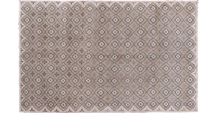 Set on gray, taupe, and neutral tones, this midcentury Turkish rug displays a unique allover pattern.