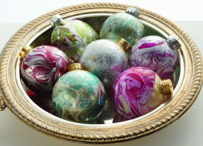 Learn how to make these beautiful DIY marbled ornaments found in ARTFUL CHRISTMAS, a book of 30 elegant craft projects from Susan Wasinger.