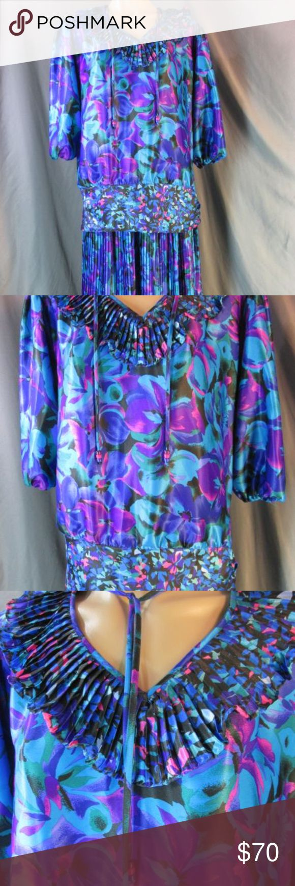 Vintage Assorti S Freis Pleated Ruffle Dress Set M Vintage 80's Assorti for Susan Freis. Bold blue purple pink green floral print. Silky polyester with a nice sheen. Bloused full cut top with pleated ruffle on the V neckline, attached tie with bead trim. Dropped waist with same fabric panel and side tie. gathered at shoulder with shoulder pads, 3/4 Sleeves with elastic end. Elastic waist skirt with narrow pleats to a lightly flared and lettuce ruffled edge finish. Made in the USA. Hand wash…
