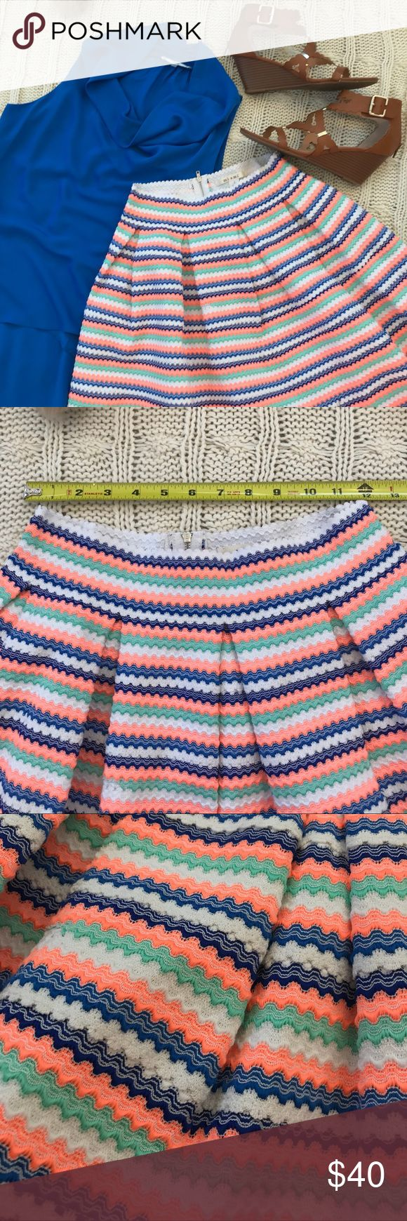 """Miami Party Skirt Blue/Coral/Green/White Sz Small Perfect for the Spring/Summer 2018 season!  These colors really pop!  The material has some good weight to it, not cheap. Scallop edging and beautiful pleats add a nice detail.  Waist has some slight stretch to it.  This listing is for SKIRT only.   Waist: 12"""", stretches to 15"""" Length: 17.5""""  One small purple spot on back, not noticeable when wearing (see pictures). Smoke free and pet free home. Always open to offers. 🍍🍍😁🍍🍍 miami Skirts…"""